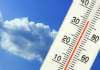 image of thermometer in front of a blue sky