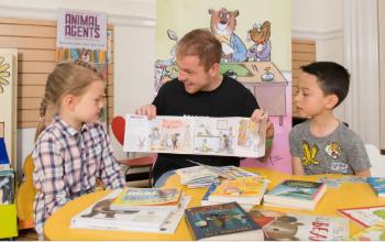 Volunteer helping young children