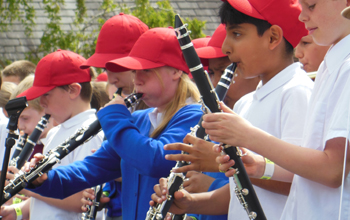 Children playing the clarinet