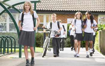 A group of school children leaving the school gates