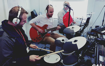 men playing guitar and drums