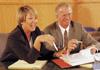 man and woman at a meeting