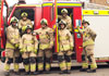 firefighters in front of fire engine