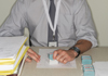 man using office rubber stamps