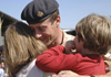 soldier greeting his family