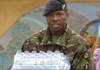 soldier carrying water bottles