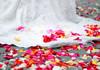 Wedding dress and rose petals