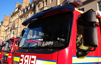 The cab of a fire appliance with the Randolph hotel in the background.