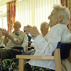 older people clapping