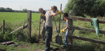 Workers improving a gate on a countryside walk