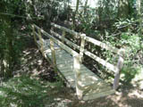Picture of a stable wooden footbridge with rail