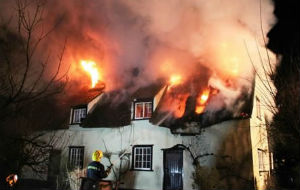 Firefighters Battle Thatched roof fire