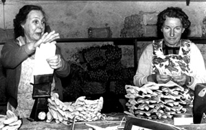 Two women making gloves, black and white