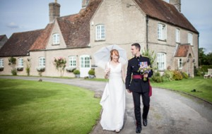 Bride and groom outside Stratton Court barn