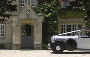 Wedding car outside house