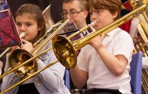 Children playing trumpets