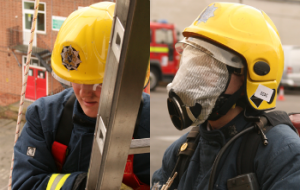 Two firefighters using equipment