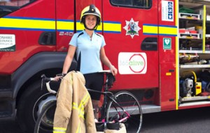 Amy on bike next to fire engine