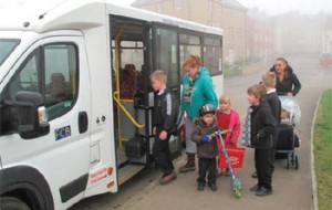 People getting onto minibus