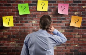Man staring at question marks