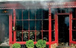 A burnt out shop front.