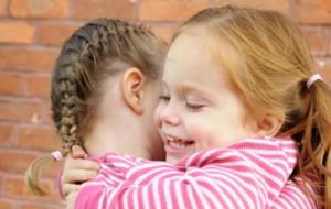 two girls hugging