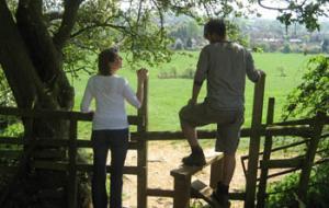 Walkers use a stile near Bloxham