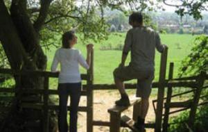 Walkers using a stile near Bloxham