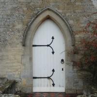 Stone and wood door to Hampton Gay church