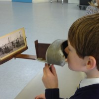 Boy looks through a stereo viewer