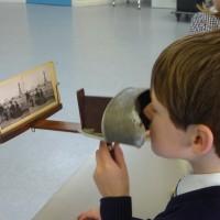 Boy looks through a stereo viewer