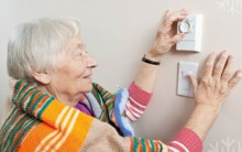 woman changing heating control